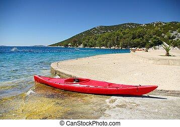 Kayak on the shore of the turquoise sea, Croatia Dalmatia ...