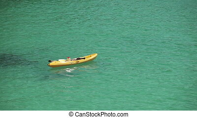Kayak on the waves near the beach n a provincial town Porto Cristo. Mallorca