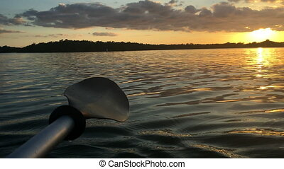 Kayak Paddle at Sunset - Kayak Paddle close-up Calm Waters...