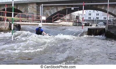 Kayak training, Kayak Race near the bridge where water ...