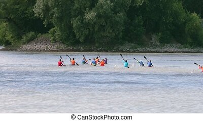 Kayak training on a river, large group of young kayakers...