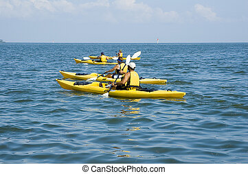 Kayak Trip - Kayakers enjoy a beautiful day on the Gulf of...