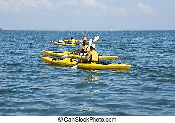 Kayak Trip - Kayakers enjoy a beautiful day on the Gulf of...