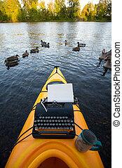 Kayak with a typewriter