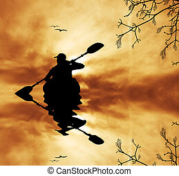 Kayaker at sunset