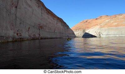 Lost Eden Lake Powell - Kayaker entering Lost Eden Lake...