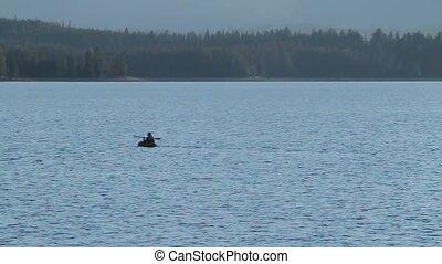 Kayaker in jackson lake Yellowstone