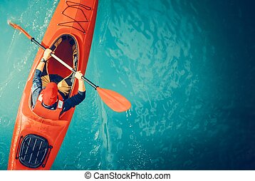 Kayaker Lake Tour Aerial Photo. Red Kayak and Caucasian...