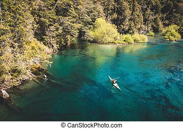 Kayaker on a beautiful lake.
