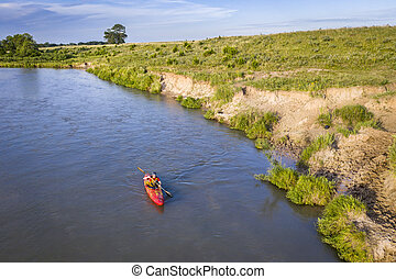 kayaker on Dismal RIver in Nebraska