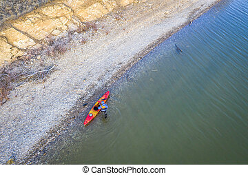 kayaker on lake shore, aerial view