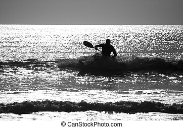 Kayaker - Silhouette of a kayaker on the shore