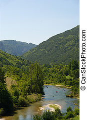 Kayakers on the river in mountain. France. Europe