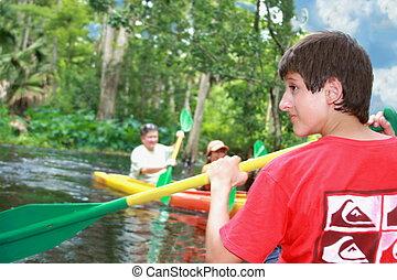 Kayaking - Boy kayaking in the river