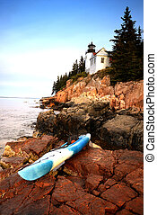 kayaking in acadia national park in Maine next to a lighthouse
