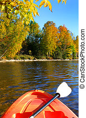 Kayaking in early Fall - Kayak on the river with trees in ...