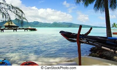 kayaks moored on beach in french polynesia