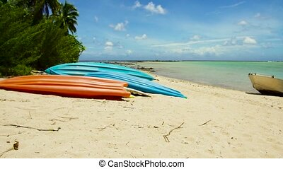 kayaks moored on beach in french polynesia - kayaking,...