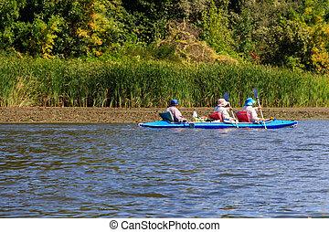 Kayaking on the beautiful river at summer