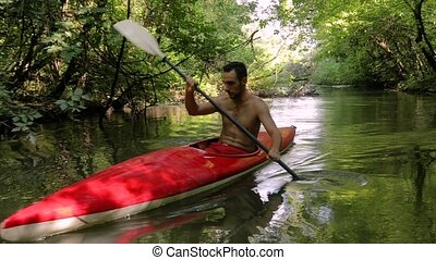Kayaking on the River - Kayaking on a small water passage....