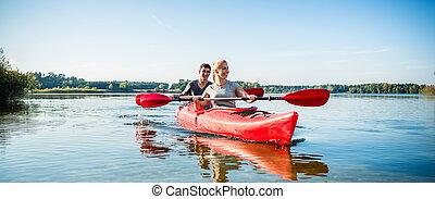 kayaking par, lago, feliz