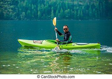 Kayaking Water Sport - Water Sport and Recreation. Caucasian...