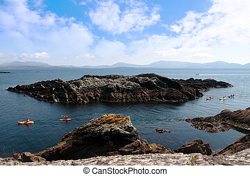 kayaks among rocky islands - kayaks in a scenic view in...