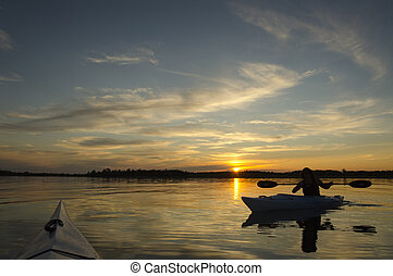 Kayaks at Sunset - Woman kayaking on Lake Ontario at sunset