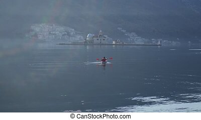 Kayaks in the lake. Tourists kayaking on the Bay of Kotor