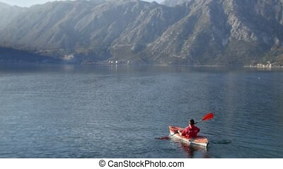 Kayaks in the lake. Tourists kayaking on the Bay of Kotor, near