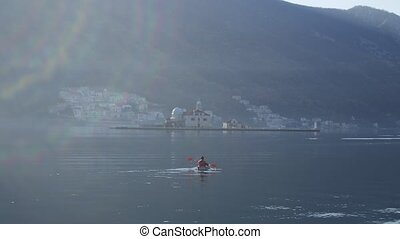 Kayaks in the lake. Tourists kayaking on the Bay of Kotor,...