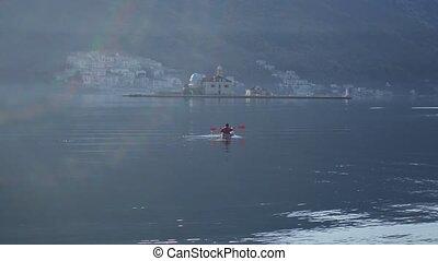 Kayaks in the lake. Tourists kayaking on the Bay of Kotor