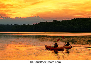 Kayaks on a Lake at Sunset.