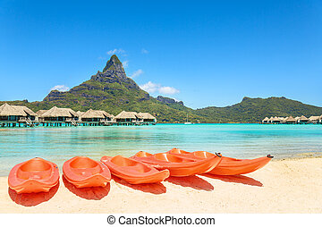 Kayaks on white sand beach, Bora Bora, Tahiti, French Polynesia, South Pacific Concept for relaxation, vacation, resort
