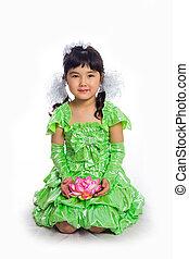 Kazakh girl of 5-6 years in a green dress, full length....