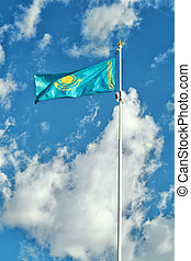 Kazakhstan flag on the background of sky.