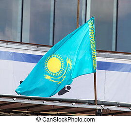 Kazakhstan flag on the roof of the house