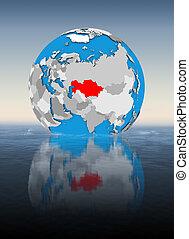 Kazakhstan on globe in water