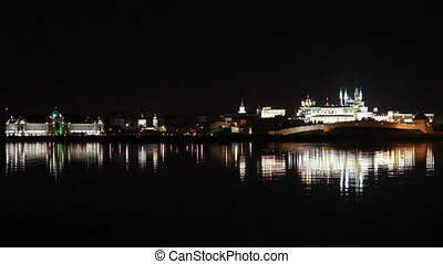kazan kremlin with reflection in river at night in russia