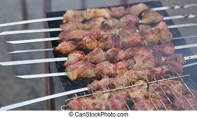 Kebab grills - Preparing kebab on the grill