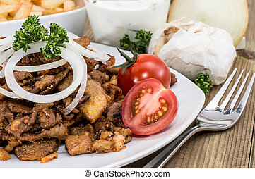 Kebab meat with Onions on a plate