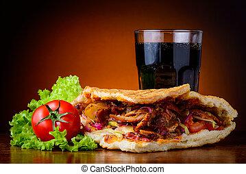 kebab, vegetables and cola drink