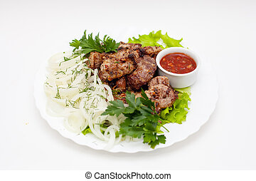 kebab with onions, herbs and sauce