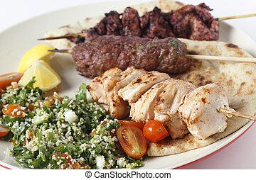Kebabe bbq meal closeup - Various barbecued kebabs - kofta,...