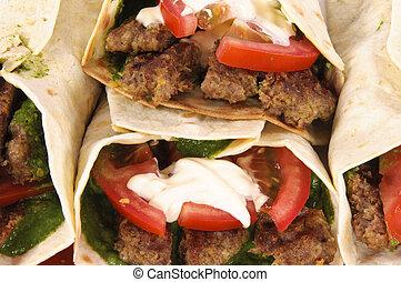 Kebabs and vegetables in tortila