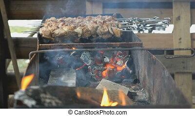 Kebabs are roasted on the metal skewers on coals - Kebabs...