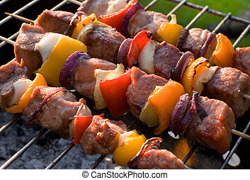 kebabs grilled with vegetables on metal skewers