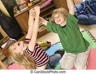 Keep Away! - Adorable twins playing keep-away on the floor.