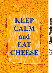 Keep calm and eat cheese message on a block of cheese