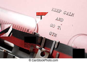 Keep calm and go to gym phrase written with a typewriter.